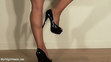 Black stiletto peep toe high heels shoes and legs walk