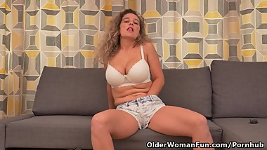 Busty milf Ameli gets bored watching TV and rubs her clit