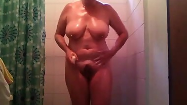 Busty housewife Stacey soaping pussy
