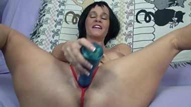 Busty housewife Melissa fucks her shaved pussy with two toys