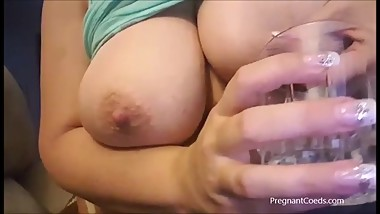 Busty 26yr old lactating Mom squirting milk in the glass