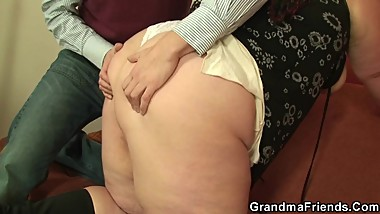 Chubby mommy swallows two young dicks
