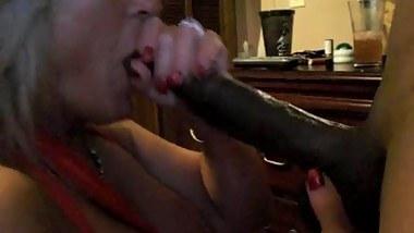 GILF Sucking huge black dick
